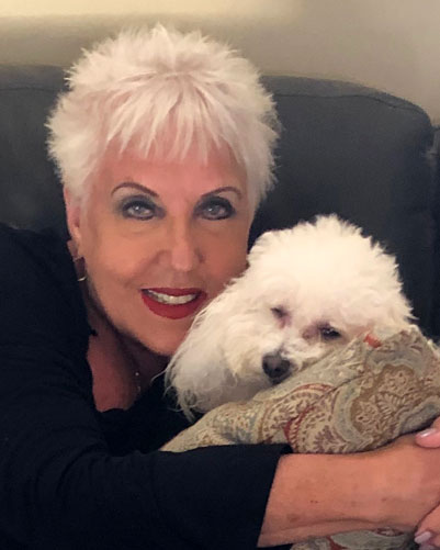 Miss Julie with her dog Curley.